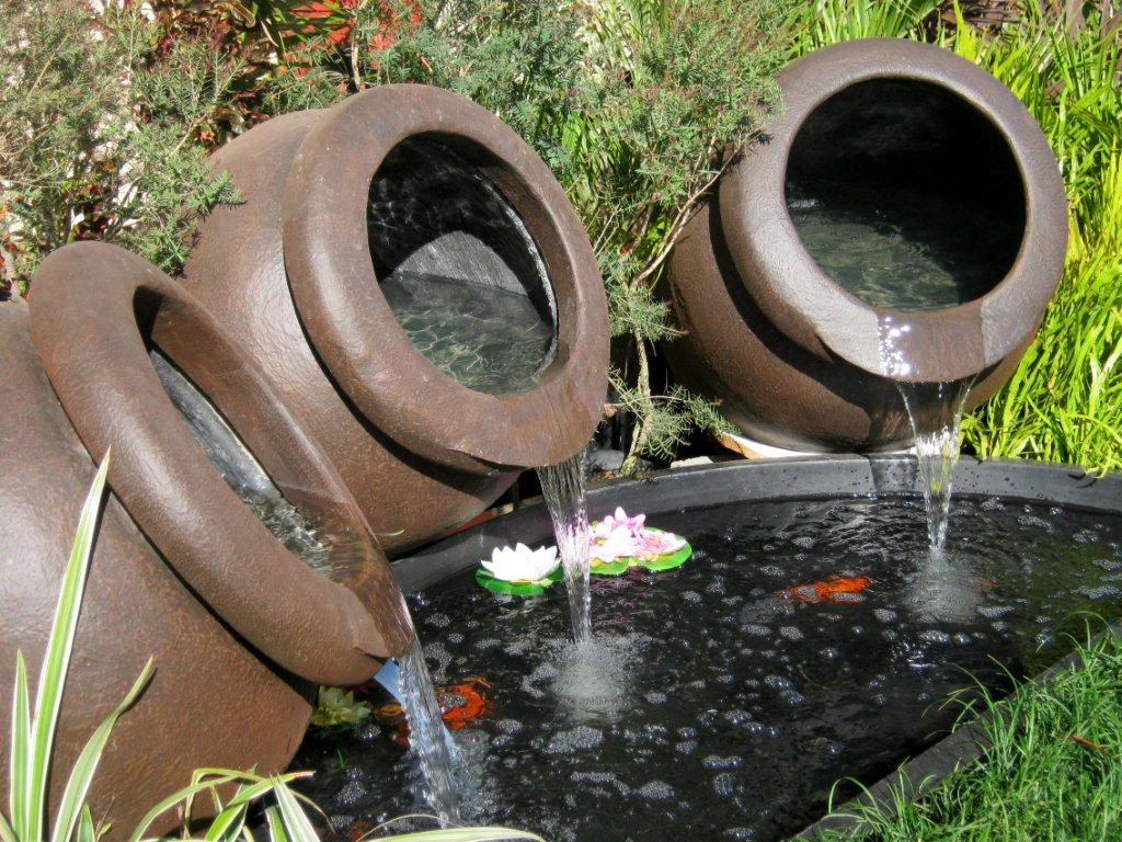 River rock designs water feature ponds gardenwise for Koi ponds durban